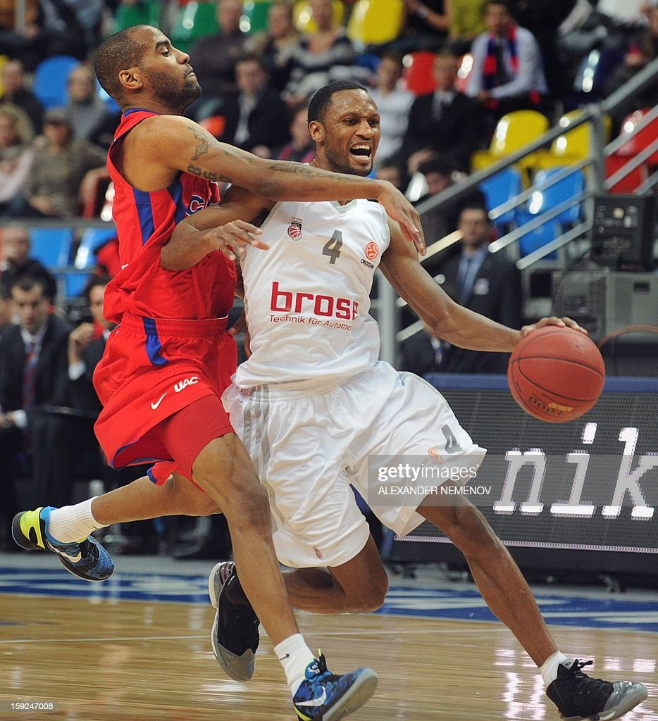 Brose Baskets' Sergerio Gibson (R) fights for the ball with CSKA Moscow's Aaron Jackson in Moscow on January 10, 2013 during a Euroleague top 16 group E game.