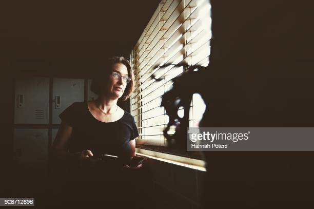 Brothel owner and director Antonia Murphy checks on the arrival of a client and safety of one of her ladies through her office window at The Bach an...