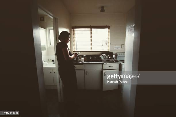 Brothel owner and director Antonia Murphy keeps an eye on the arrival of a client and safety of one of her ladies from the kitchen window at The Bach...