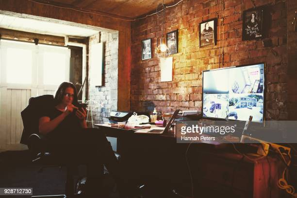 Brothel owner and director Antonia Murphy takes another booking on her phone in her office at The Bach an ethical escort service on October 19 2017...