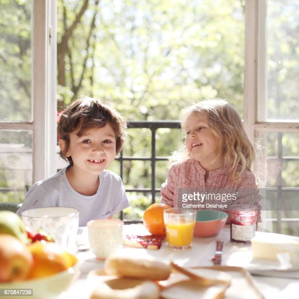 a brother and a sister having their breakfast - sister stock pictures, royalty-free photos & images
