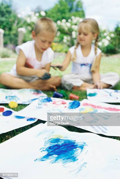 Brother and his sister finger painting