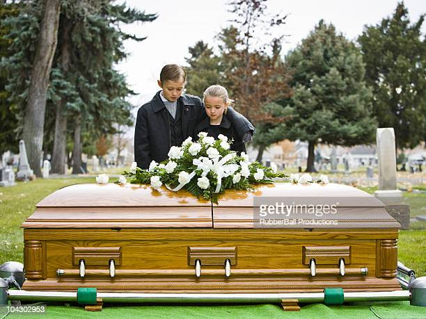 brother and sister at a funeral - coffin stock pictures, royalty-free photos & images