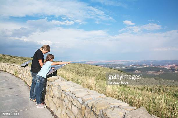 Brother and sister at a scenic overlook
