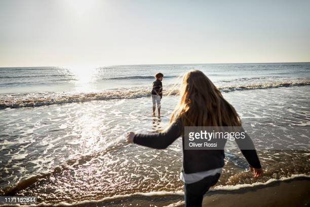 brother and sister at the sea - north sea stock pictures, royalty-free photos & images