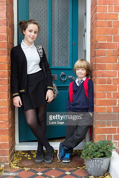 brother and sister before school - doorway stock pictures, royalty-free photos & images
