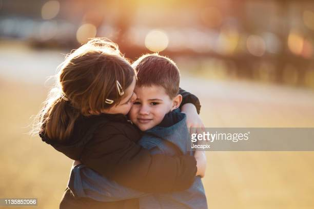 brother and sister bonding - sister stock pictures, royalty-free photos & images