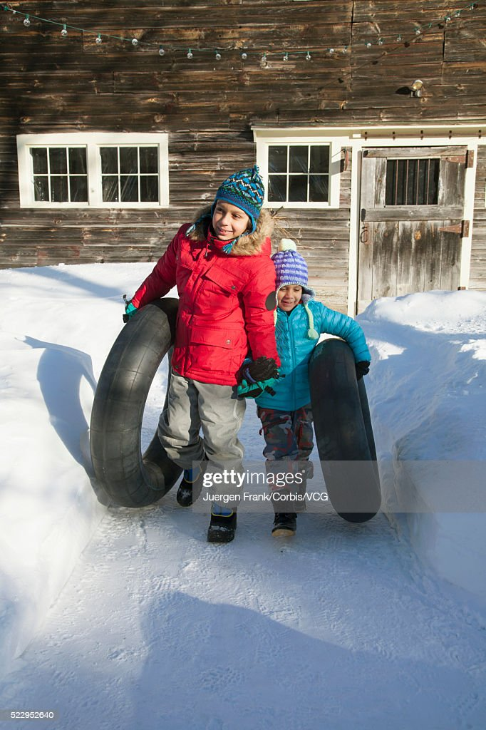 Brother 8 9 And Sister 6 7 Carrying Inner Tubes