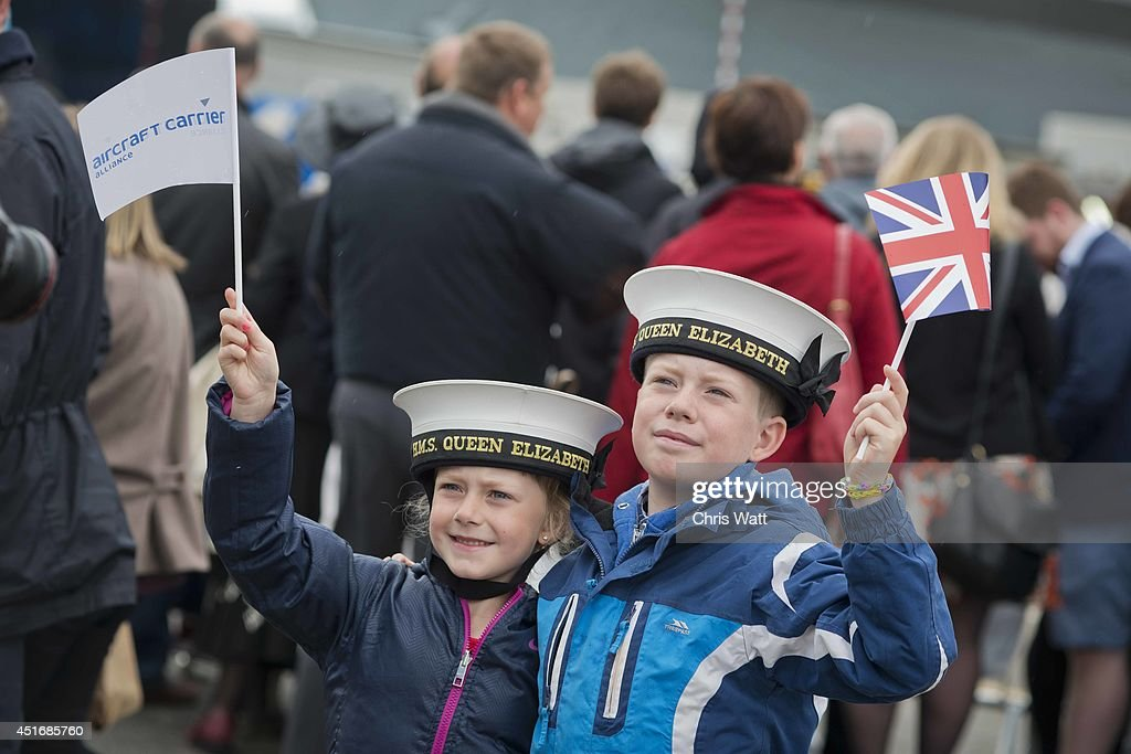 Brother and Sister celebrate the naming of Royal Navy's new aircraft carrier HMS Queen Elizabeth by Queen Elizabeth II on July 4, 2014 in Rosyth, Scotland. HMS Queen Elizabeth is the largest warship ever built in the UK weighing 65,000-tonnes, six shipyards around the UK have been involved in building various parts of the carrier. The ship is capable of carrying up to forty aircraft, is scheduled to be launched later this summer, and to commission in early 2017, with full operational capability from 2020.