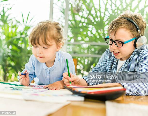brother and sister coloring the book