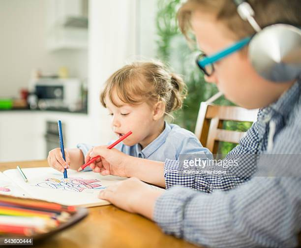 brother and sister coloring the book - karina urmantseva stock pictures, royalty-free photos & images