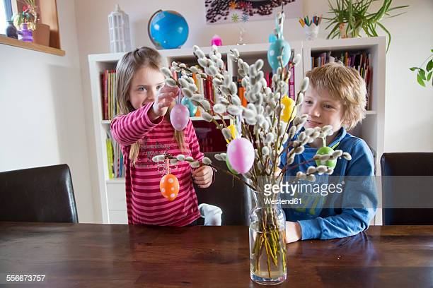Brother and sister deocrating Easter bouquet