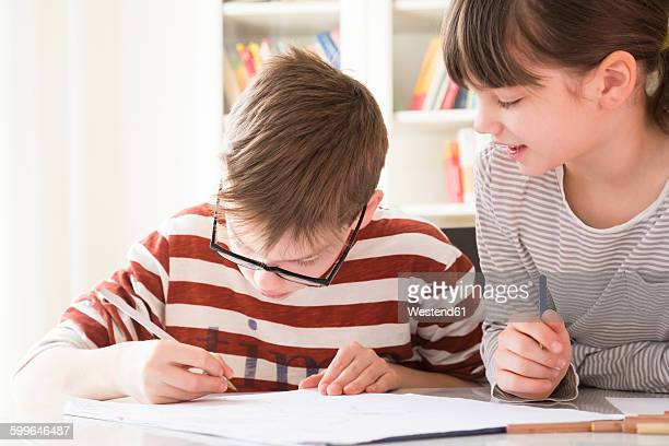 Brother and sister drawing together
