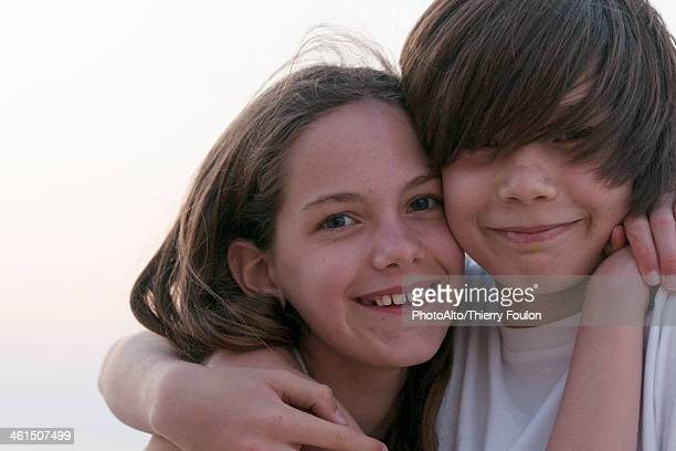 Brother and sister embracing, portrait