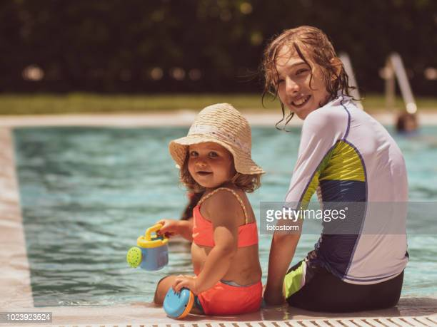 Brother and sister having fun at the pool