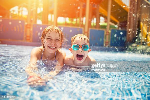 Brother and sister having fun in water park