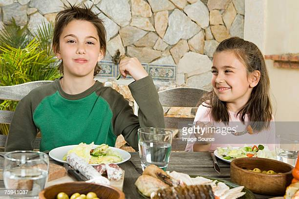 Brother and sister having meal