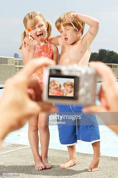 Brother and sister having picture taken