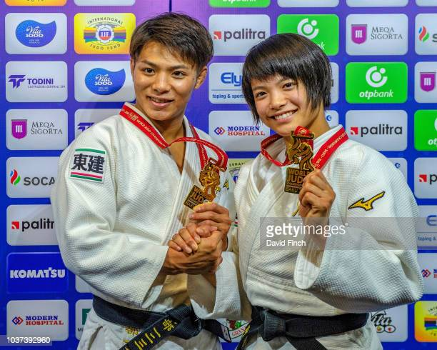 Brother and sister Hifumi Abe left and Uta Abe hold hands and show their gold medals while enjoying the unique position of being the first brothers...