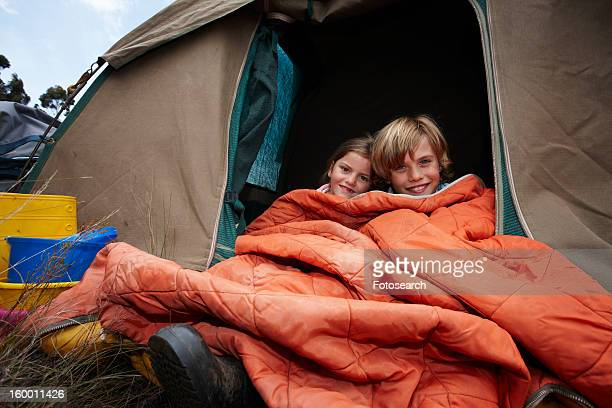 Brother and sister in a tent