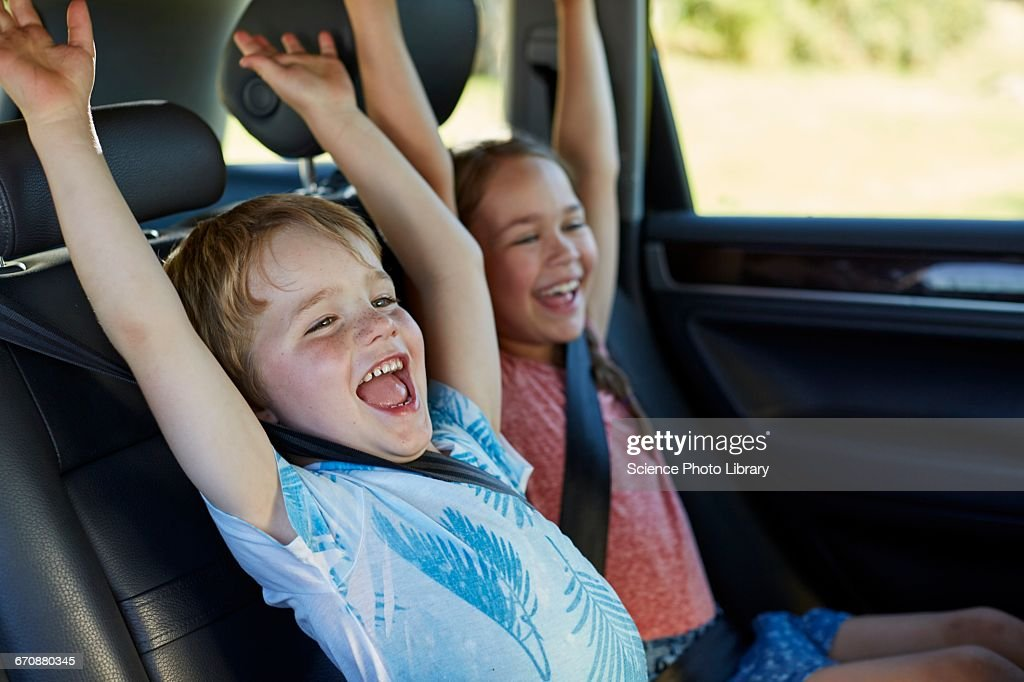 Brother and sister in car : Stock Photo