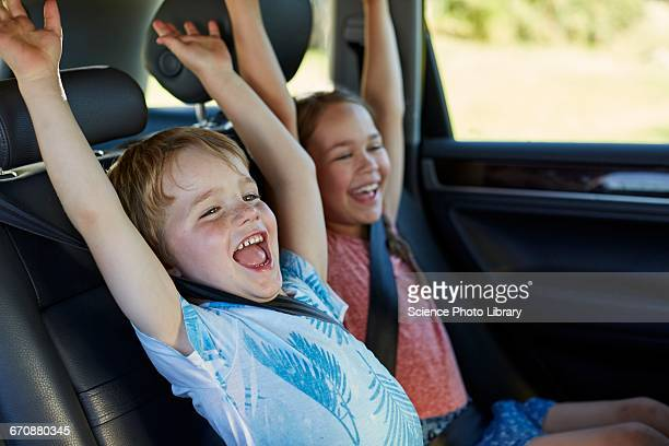 brother and sister in car - happy family in car stock photos and pictures