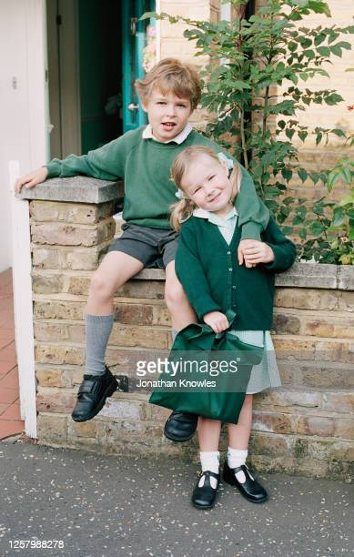 brother and sister in school uniforms - school child stock pictures, royalty-free photos & images