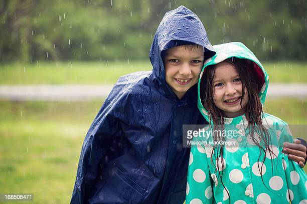 Brother and sister in the rain