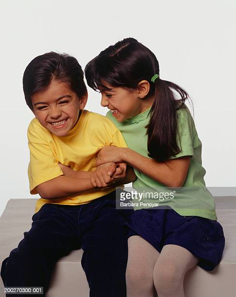 brother and sister laughing, posing in studio, portrait - boys wearing tights stock photos and pictures