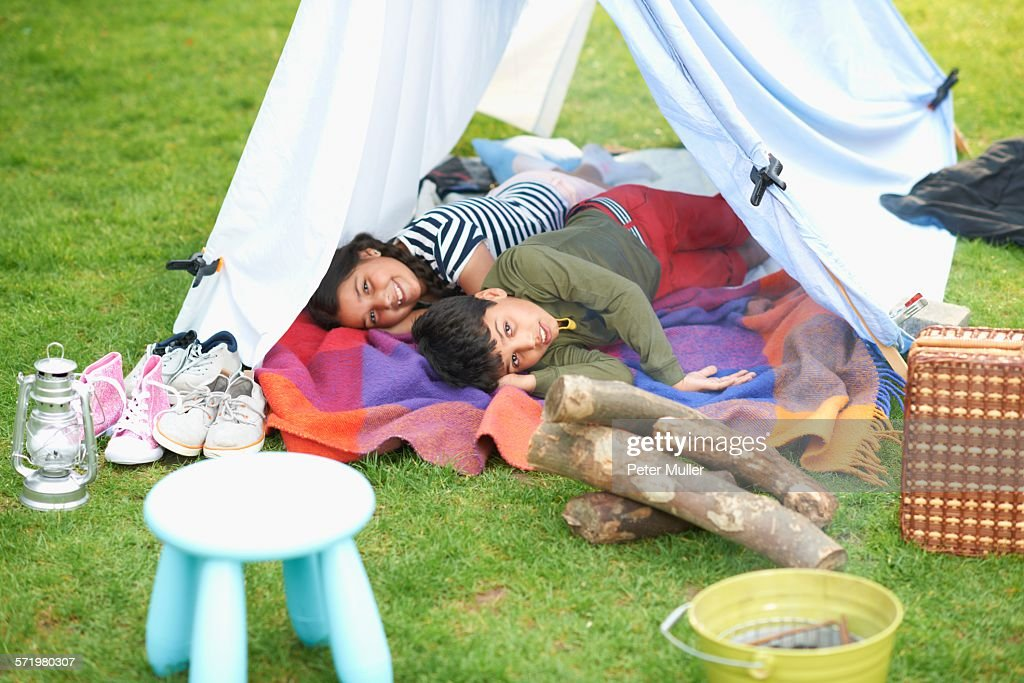 Brother And Sister Lying In Homemade Tent In Garden Stock Photo | Getty Images & Brother And Sister Lying In Homemade Tent In Garden Stock Photo ...