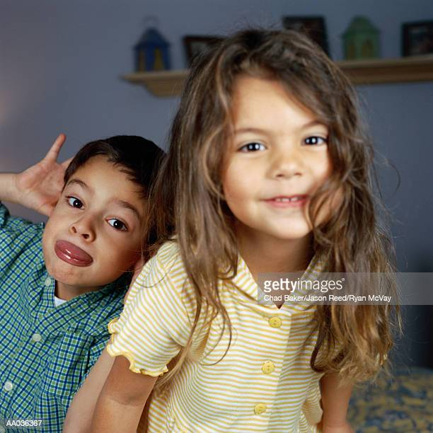 Brother and Sister Making Faces