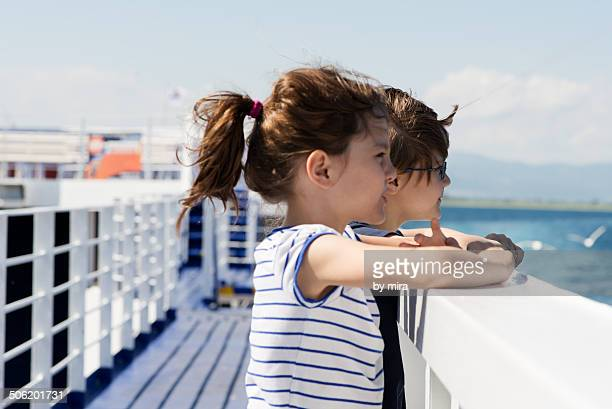 brother and sister on a ferry - ferry stock photos and pictures