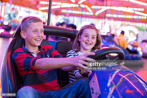 Brother and sister on fairground bumper cars