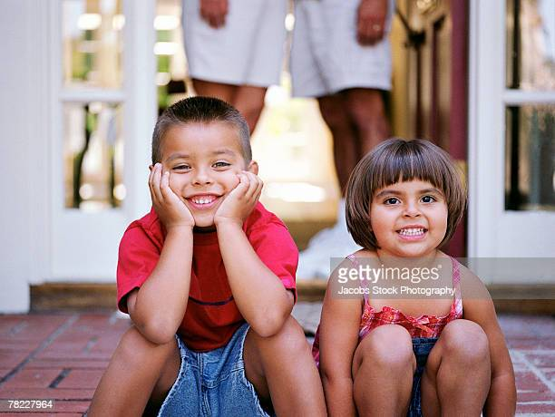 brother and sister - girls open legs stock photos and pictures