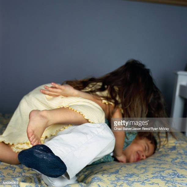 brother and sister play fighting - girl fight stock photos and pictures