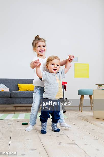 Brother and sister playing at home