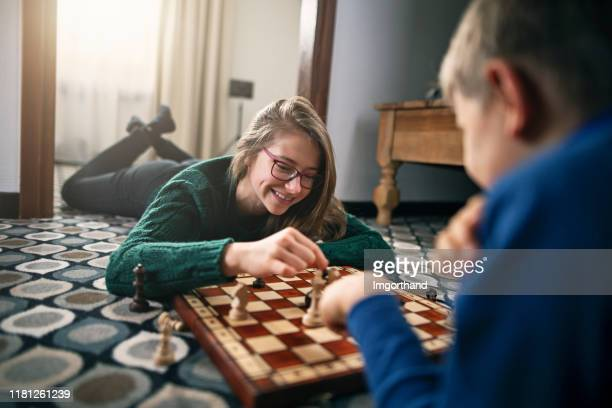 brother and sister playing chess - game night leisure activity stock pictures, royalty-free photos & images