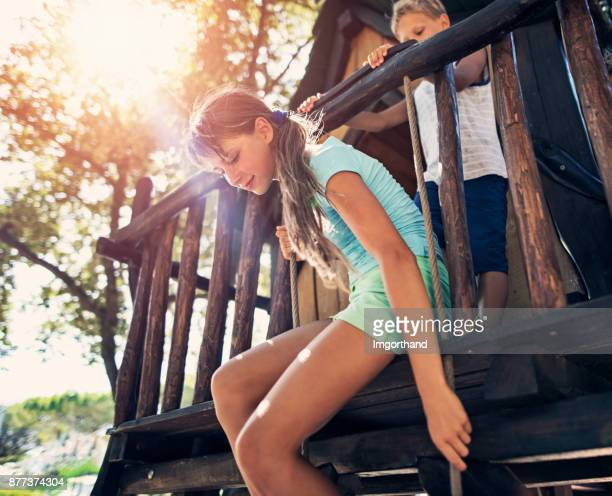 brother and sister playing in a tree house - shack stock pictures, royalty-free photos & images