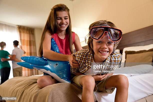 brother and sister playing in hotel room. - children only stock pictures, royalty-free photos & images