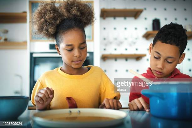 brother and sister playing in the kitchen. - electric stove burner stock pictures, royalty-free photos & images