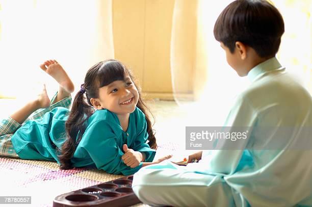 Brother and Sister Playing Mancala