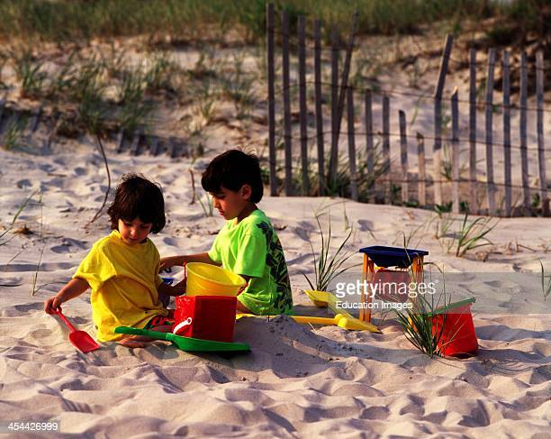 Brother And Sister Playing On Beach