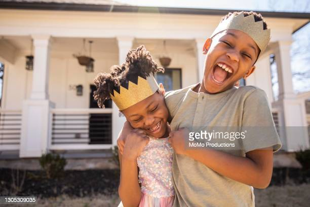 brother and sister playing outside and wearing homemade crowns - crown stock pictures, royalty-free photos & images