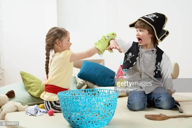 brother and sister playing - puppet stock photos and pictures