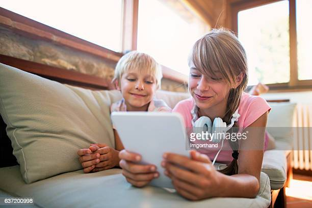Brother and sister playing with tablet