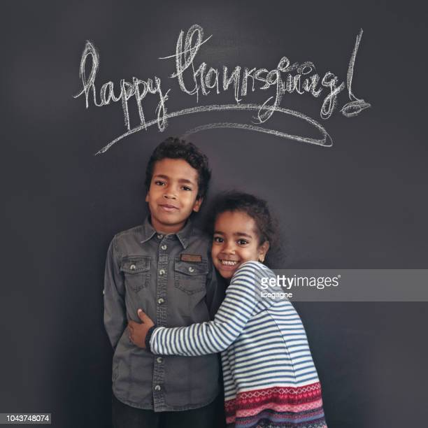 brother and sister portrait - happy thanksgiving text stock pictures, royalty-free photos & images