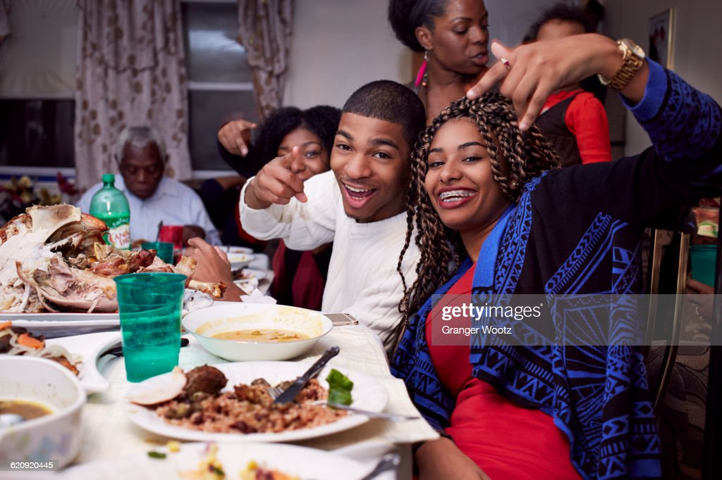 Brother and sister posing at dinner table : Stock Photo