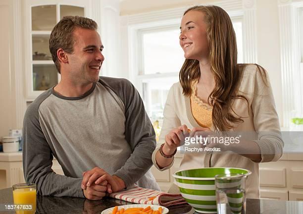 Brother and sister preparing food