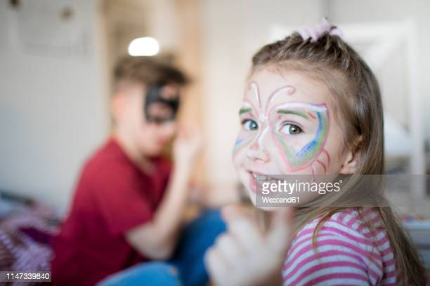 brother and sister preparing for carneval - kids makeup stock pictures, royalty-free photos & images