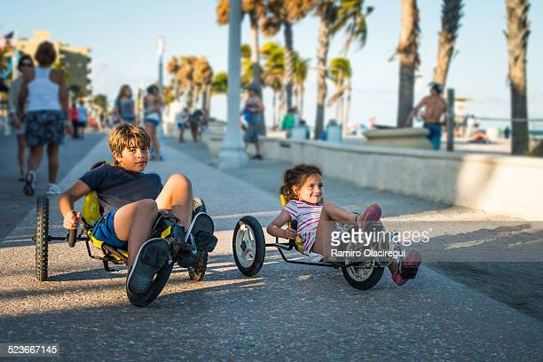 Brother and sister riding bicycle